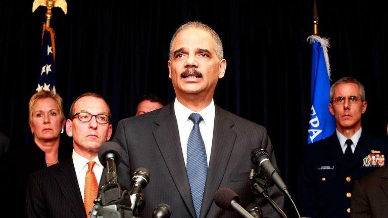 U.S. Attorney General Eric Holder addresses the media