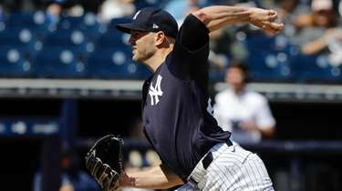 The Yankees' J.A. Happ delivers a pitch during