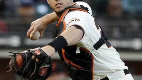 San Francisco Giants catcher Buster Posey (28) throws