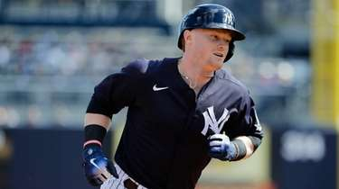 The Yankees' Clint Frazier runs the bases after