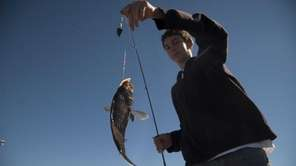 Kevin Fish, 15, of Bellmore, catches a sea