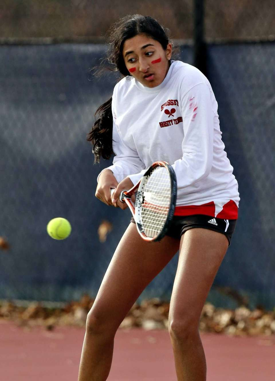 Syosset second singles player Rithika Reddy hits a
