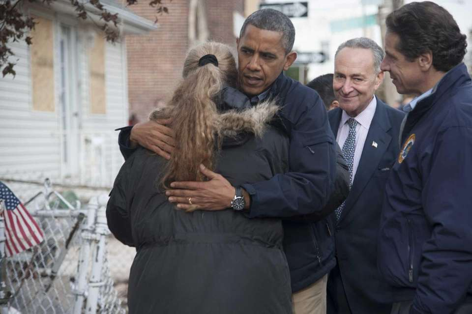 President Barack Obama hugs New Dorp Beach, Staten