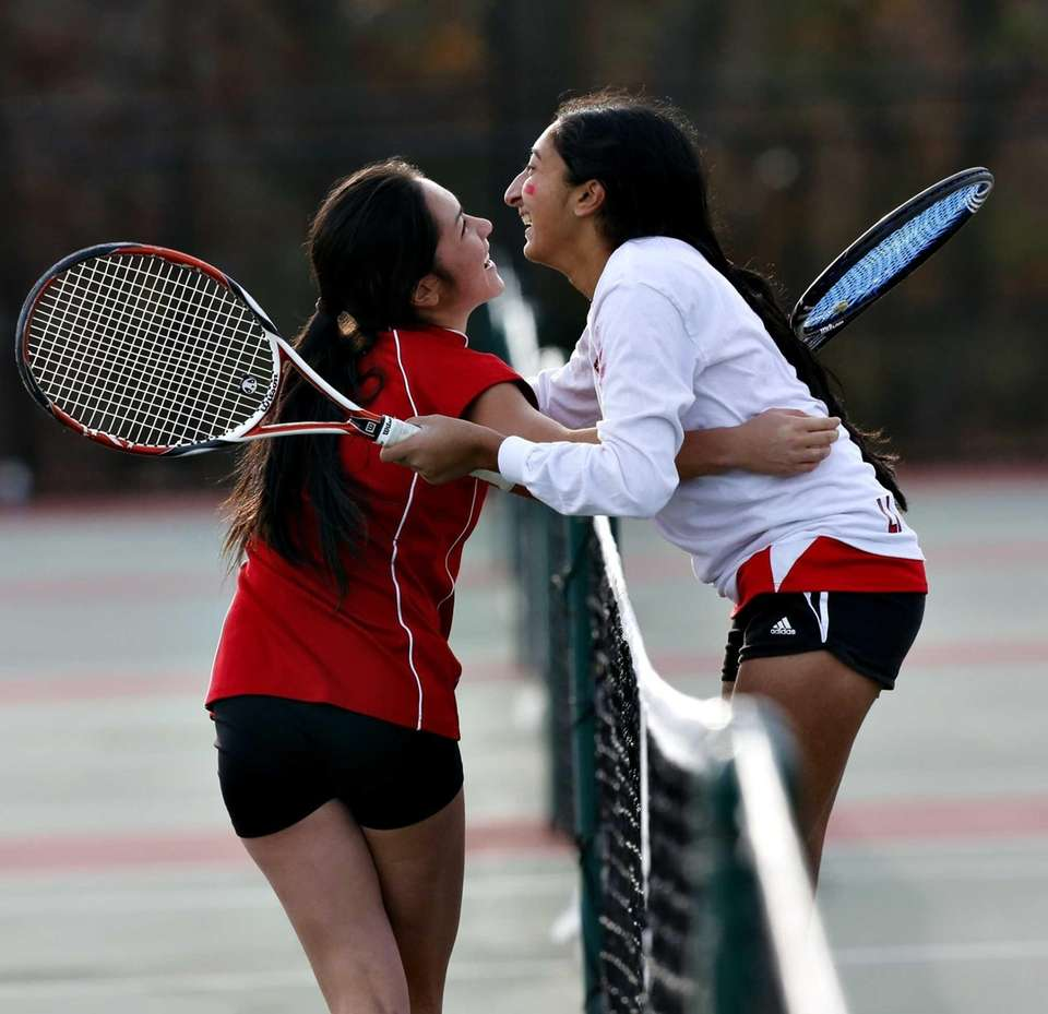 Syosset second singles player Rithika Reddy, right, and