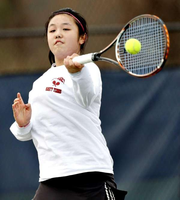 Syosset first singles player Vivian Cheng hits a