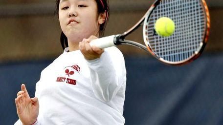 Syosset first singles player Vivian Cheng hits a