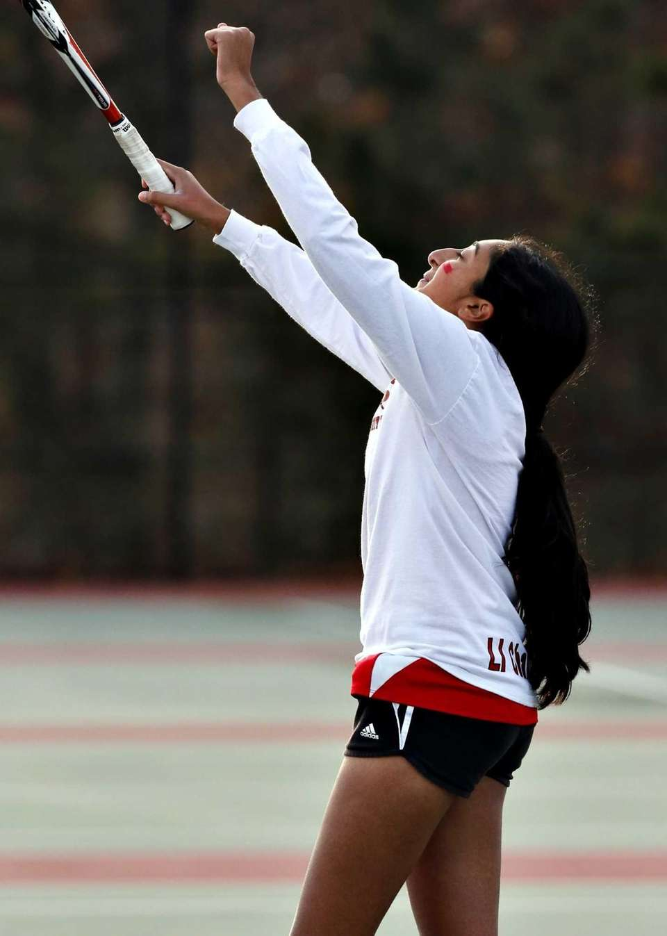 Syosset second singles player Rithika Reddy reacts after