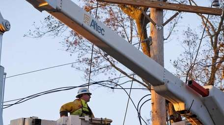 A National Grid lineman goes skyward in a