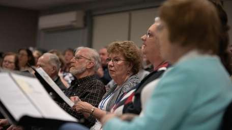 Members of the Babylon Chorale rehearsed an ambitious