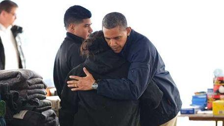 President Obama hugs a woman as he visits
