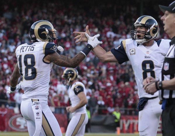 St. Louis Rams wide receiver Austin Pettis, left,