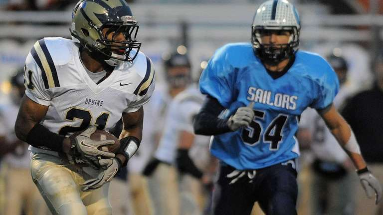 Baldwin's Treyvon Mask, left, rushes for a gain