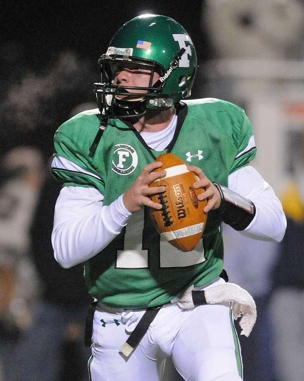 Farmingdale quarterback Joe Valente looks for an open