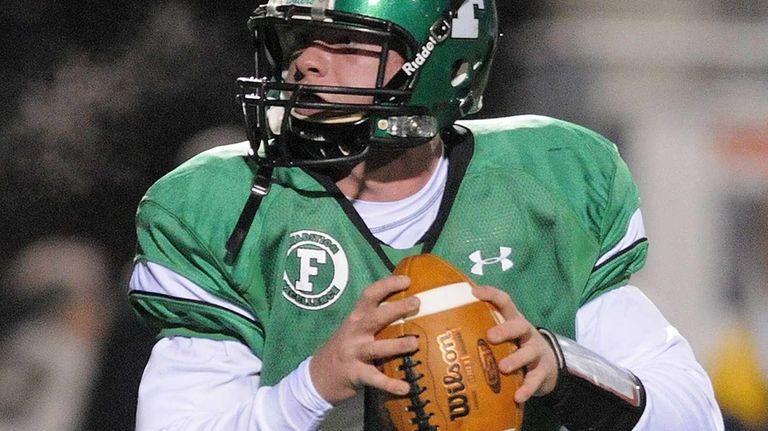Farmingdale quarterback Joe Valente looks for an open