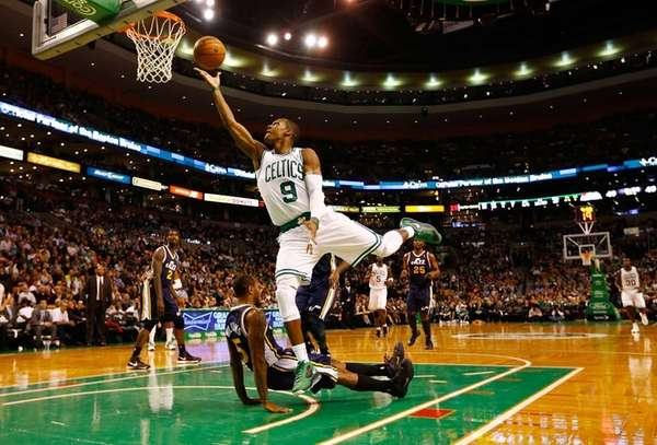 Boston Celtics guard Rajon Rondo goes up for