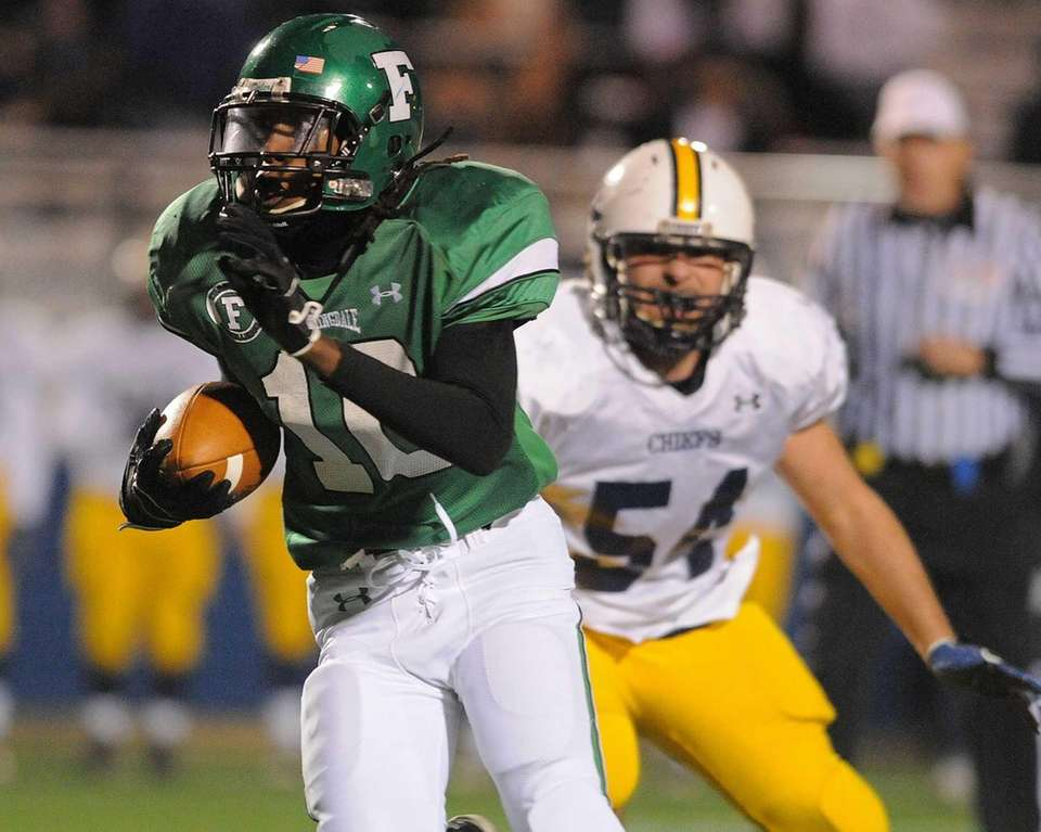 Farmingdale's Curtis Jenkins rushes for a gain in