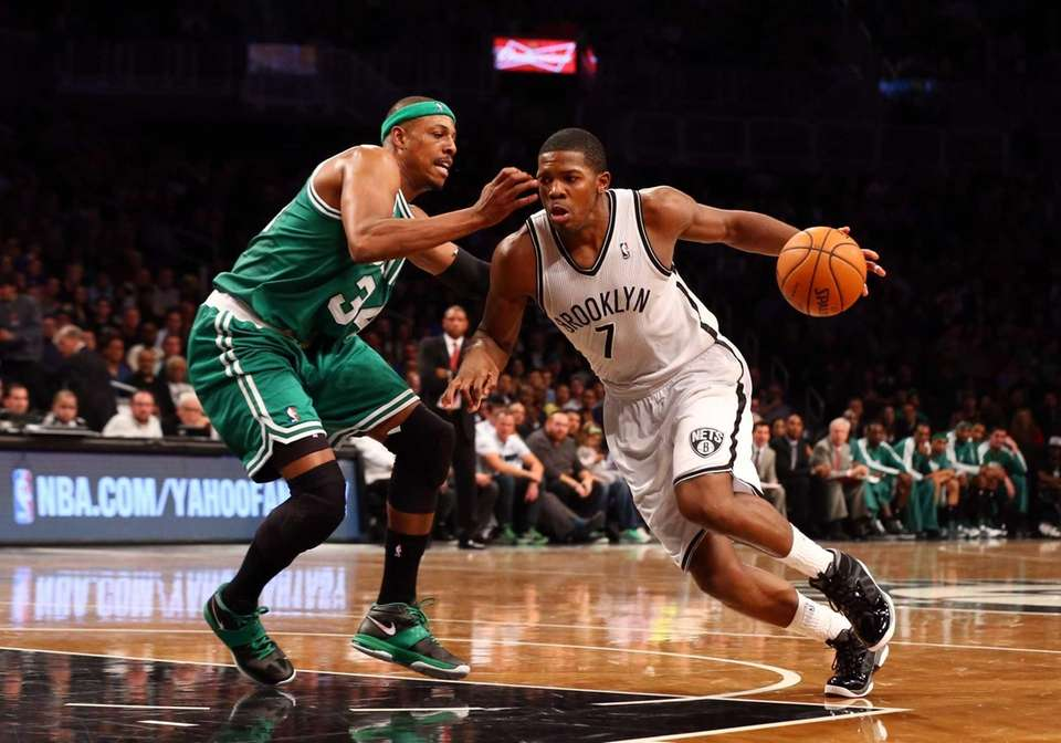 Joe Johnson tries to drive past Paul Pierce
