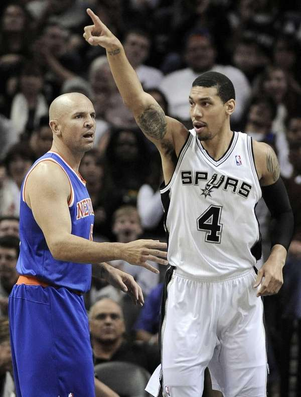 The San Antonio Spurs' Danny Green, right, celebrates