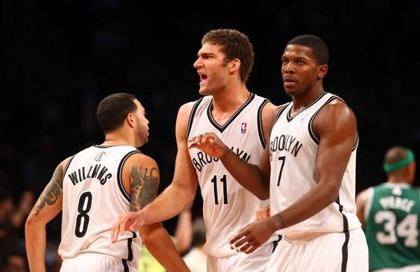 Brook Lopez celebrates a fourth-quarter basket against the