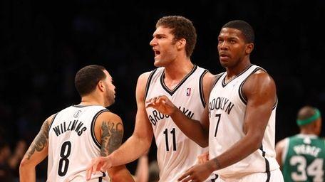 Brook Lopez celebrates a fourth-quarter basket against the
