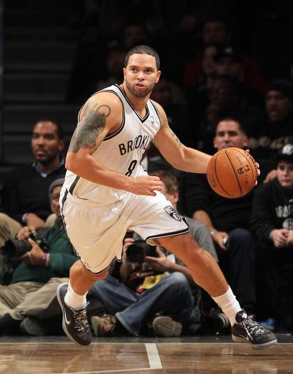 Deron Williams of the Brooklyn Nets controls the