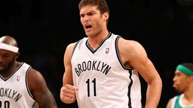 Brook Lopez celebrates a fourth quarter basket against