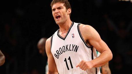 Brook Lopez celebrates a fourth quarter basket against