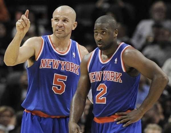 Jason Kidd, left, talks to teammate Raymond Felton during the second half of a game against the <a href=