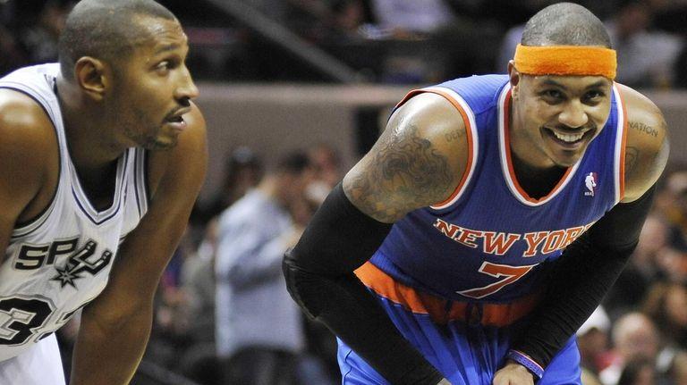 New York Knicks' Carmelo Anthony, right, smiles next