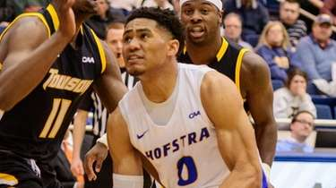Hofstra guard Tareq Coburn goes to the hoop