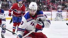 Mika Zibanejad of the Rangers skates the puck