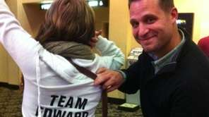 Drew Appelbaum displays Erika Wolff's homemade 'Team Edward'