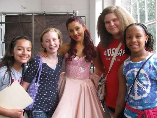 Actress Ariana Grande with Kidsday reporters (l) Mia