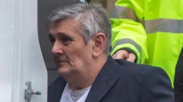 John Pierotti leaves the Nassau County Court in
