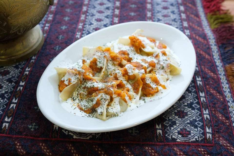Mantu dumplings are filled with chicken and double-drizzled