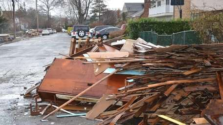 Discarded furniture and flooring lined the sidewalks in