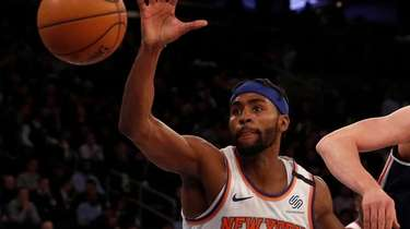 Maurice Harkless of the New York Knicks reaches