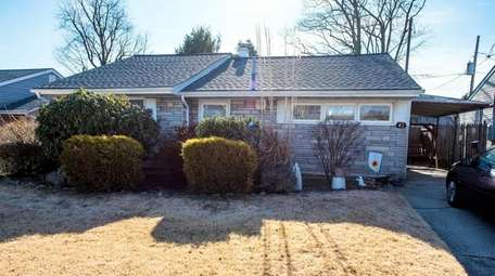 Priced at $449,000, this three-bedroom, one-bathroom ranch sits
