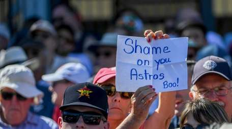 A fan holds a sign during a spring