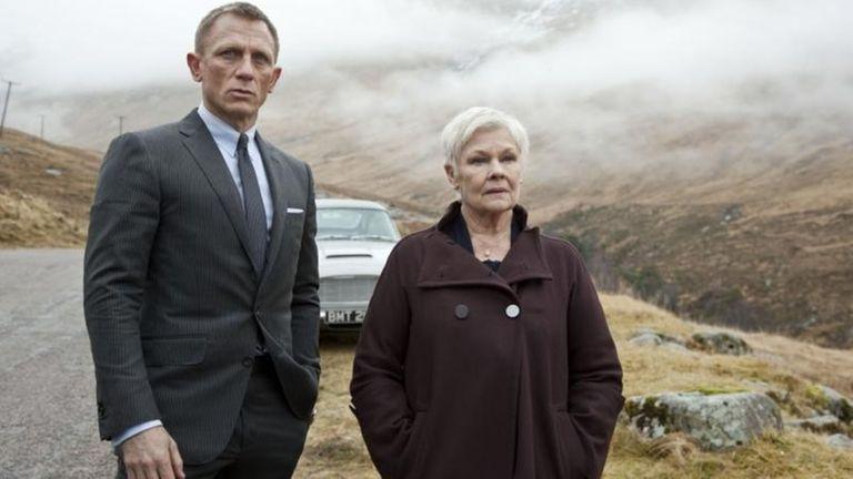 Daniel Craig as James Bond and Judi Dench