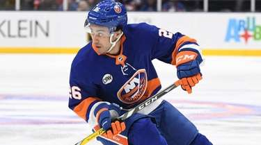 New York Islanders right wing Josh Ho-Sang skates