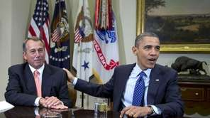 President Barack Obama acknowledges House Speaker John Boehner