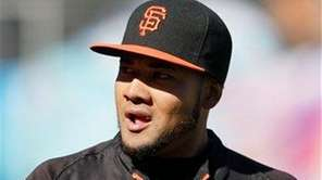 Then-San Francisco Giants center fielder Melky Cabrera stands