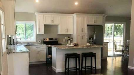 The kitchen has stainless steel appliances.