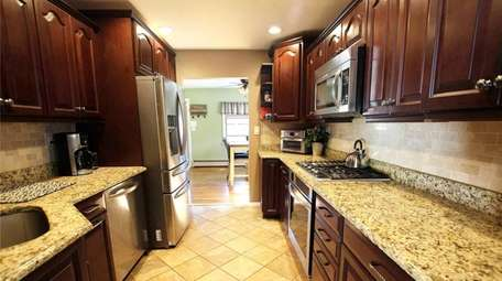 The kitchen has granite countertops and stainless-steel appliances.
