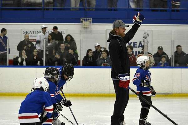 Brad Richards skates with children during a charity