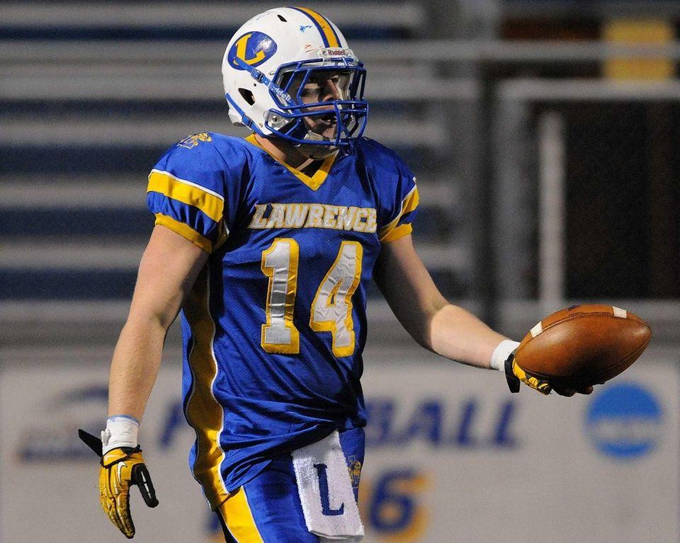 Lawrence High School wide receiver Ed Robinson prepares