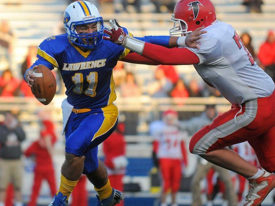 Lawrence High School quarterback Joe Capobianco, left, gets