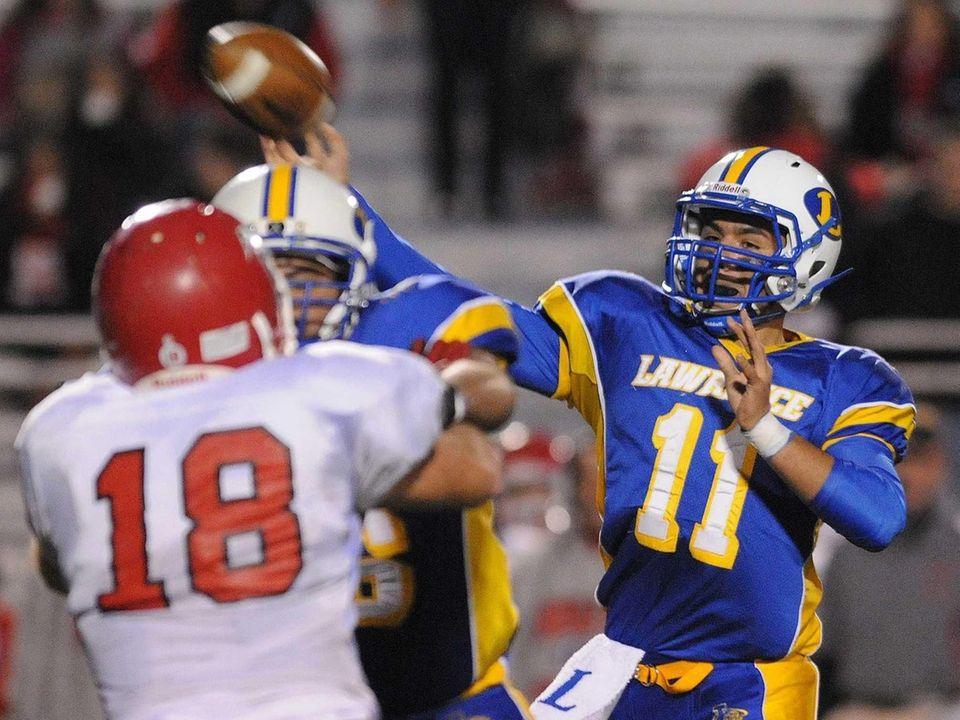 Lawrence High School quarterback Joe Capobianco throws a