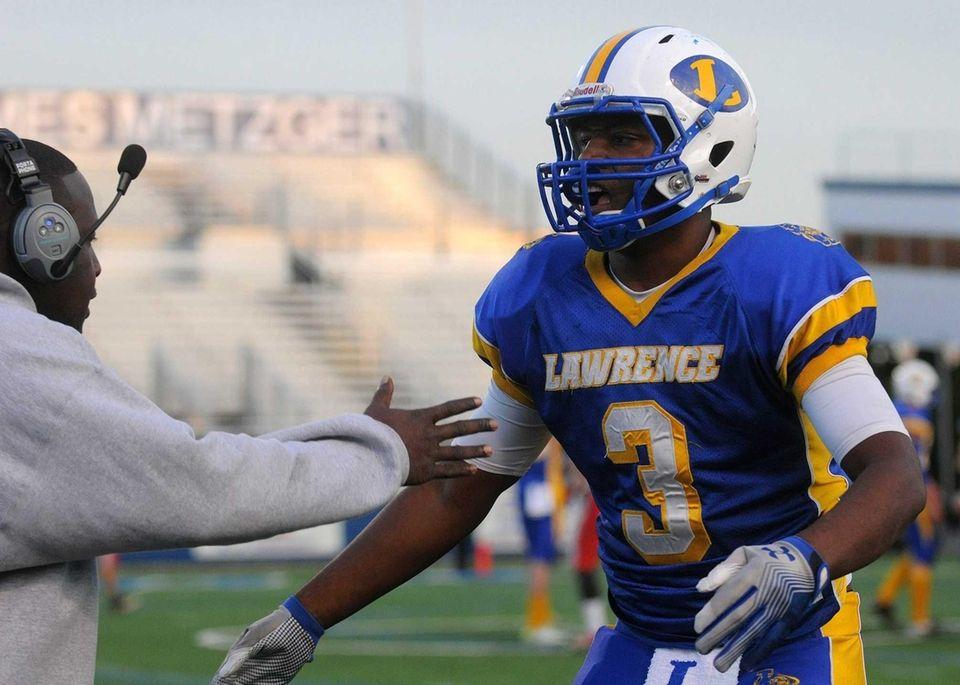 Lawrence High School running back Tyler Fredericks, right,